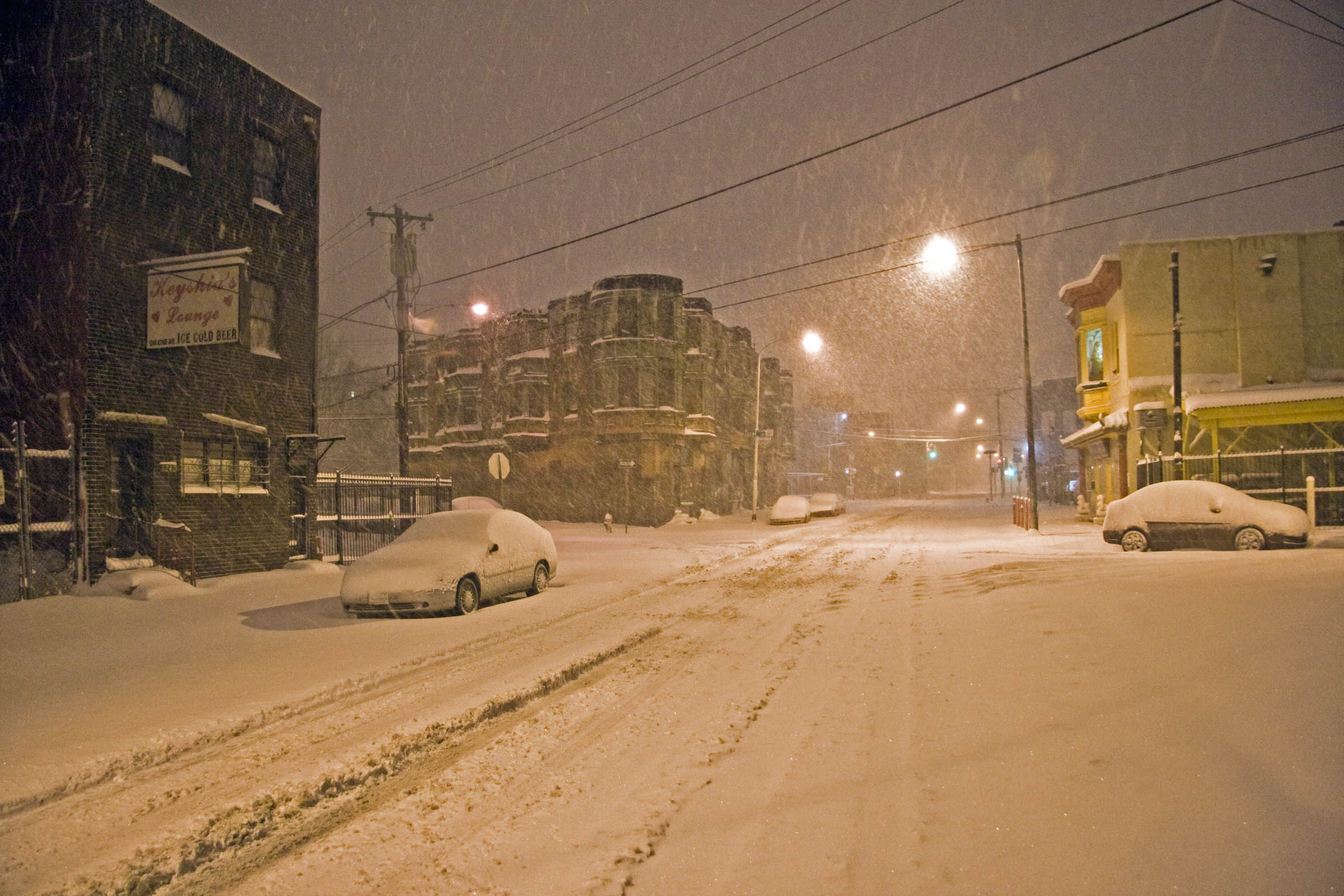 Night shot of snow falling on Ridge Avenue, Philadelphia, PA, 2010.