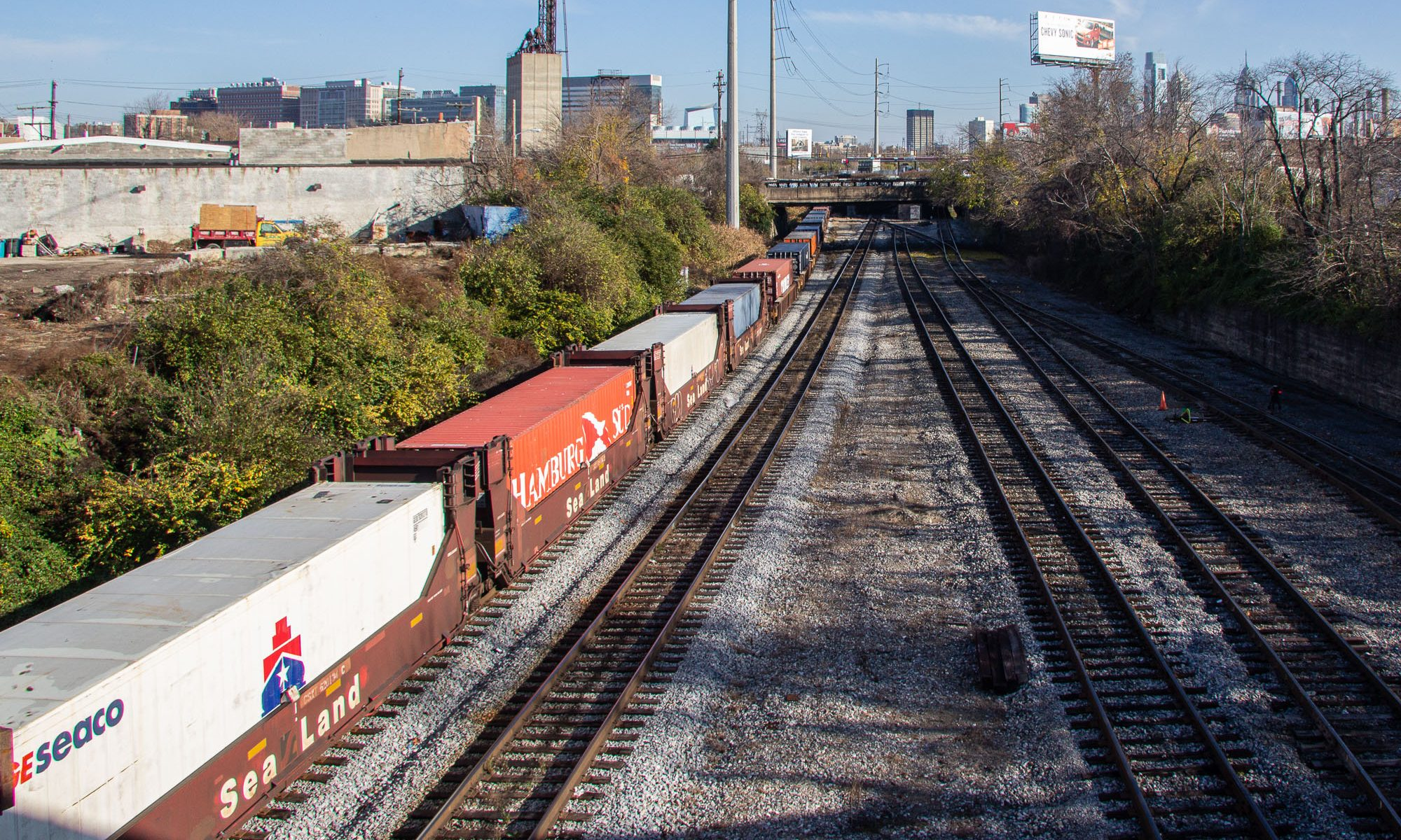 This article is about Docker containers, but here are some shipping containers on railcars. Philadelphia, PA, 2011.